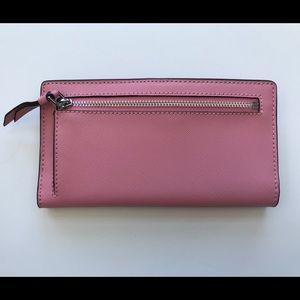 kate spade Bags - Kate spade pink large slim bifold wallet NEW